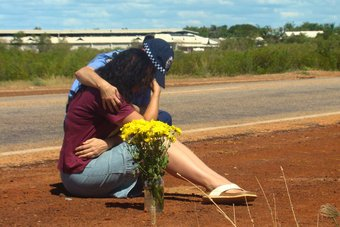 Ingrid Bishop is consoled after remembering son