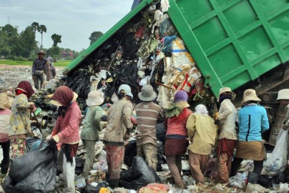 People scrounge for food at a Cambodian rubbish dump