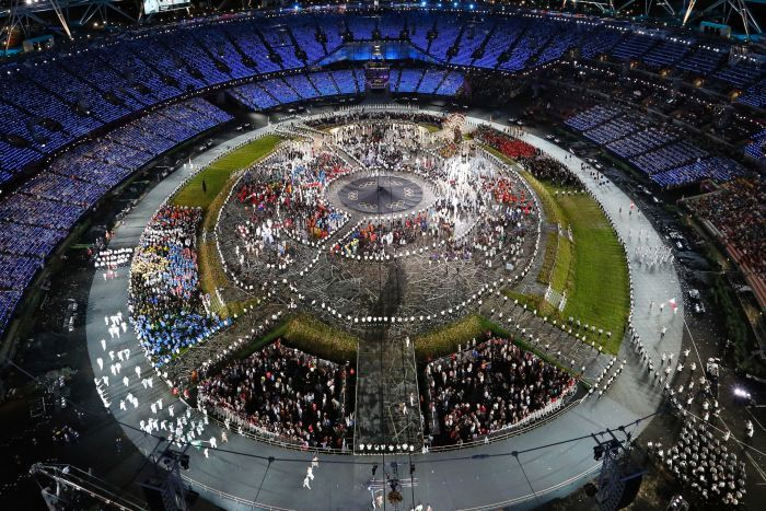Athletes parade around the Olympic Stadium during the opening ceremony.
