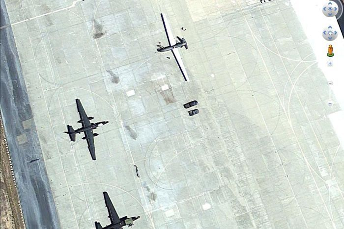 A Global Hawk drone and two U2 manned spy planes on the tarmac at Beale Air Force Base in California.