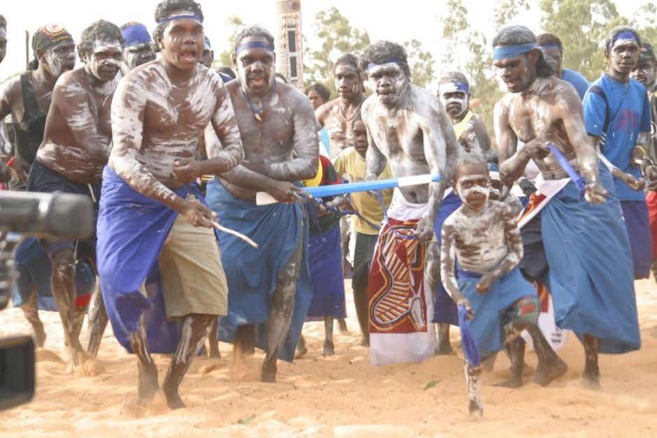 Dancers from the Blue Mud Bay region of north-east Arnhem Land sing in celebration at the annual Garma Festival of Traditional Culture. Image Credit: ABC https://i1.wp.com/www.abc.net.au/news/image/475930-3x2-940x627.jpg