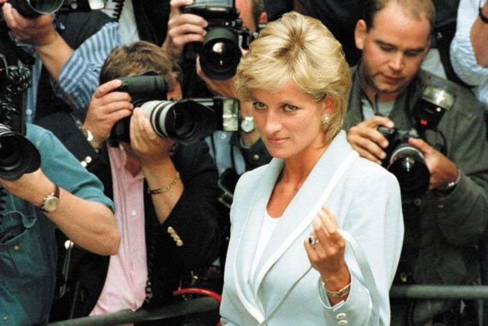 Princess Diana surrounded by paps