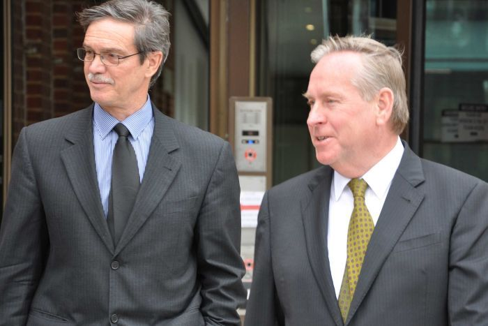 WA Premier Colin Barnett and then-energy minister Mike Nahan walking side by side.