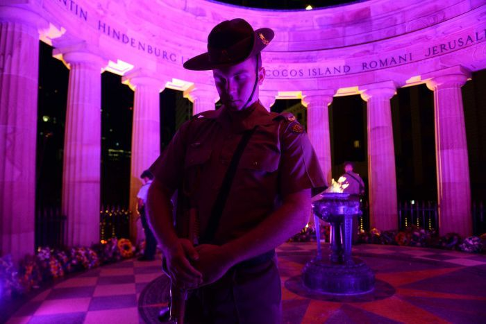 A soldier stands guard during an Anzac Day dawn service at the Cenotaph in Brisbane.