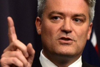 Finance minister Mathias Cormann speaks during a press conference.