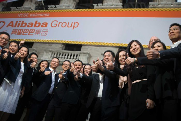 Senior members of the Alibaba group poses for photos at the NYSE