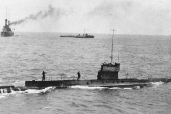 Photo of a submarine and two warships