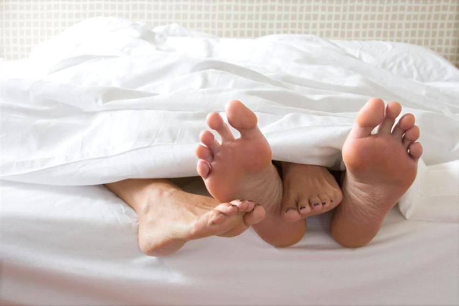 Image result for couple in bed feet hanging out