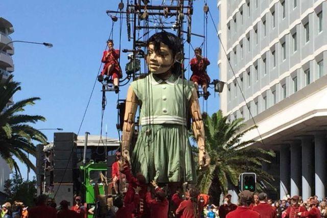 Giant marionette walks through Perth streets