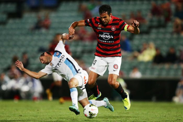Nikolai Topor-Stanley and Massimo Murdocca battle for possession
