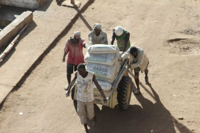 Workers push a cart on the island of Lamu