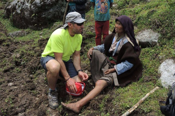 Adrian Hayes assists a Nepalese woman