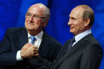 Sepp Blatter shakes hands with Vladimir Putin in Russia on Saturday, July 25