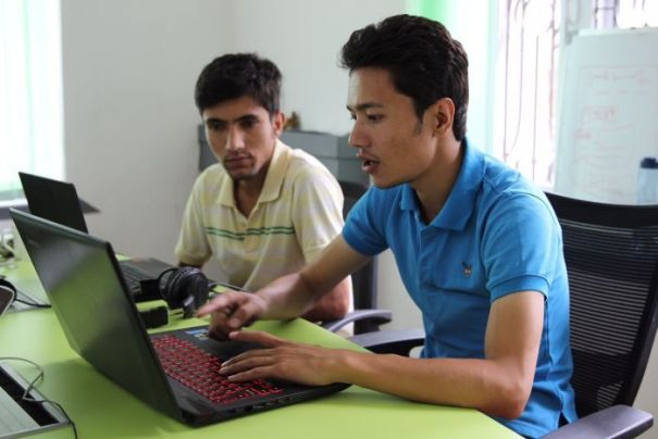 Sazal Sthapit and Pujan Poudel work on Quakemap.org