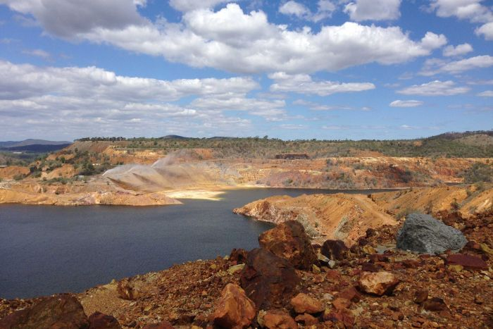 The main pit at the old Mount Morgan mine which is now filled with contaminated water