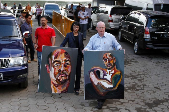 ONE TIME USE Bali Nine Lawyer Julian McMahon carries Myuran Sukumaran paintings