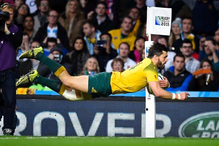 Adam Ashley-Cooper flies through the air to score a try against Argentina during the Rugby World Cup semi-final.