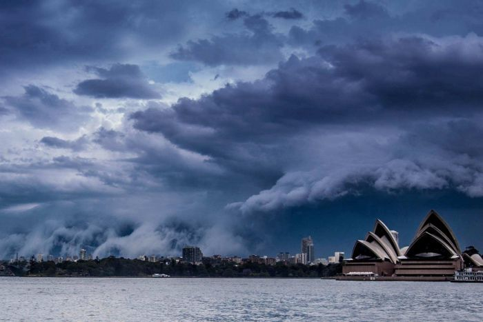 A shelf cloud rolls over Sydney, with the Sydney Opera House prominent in the foreground.