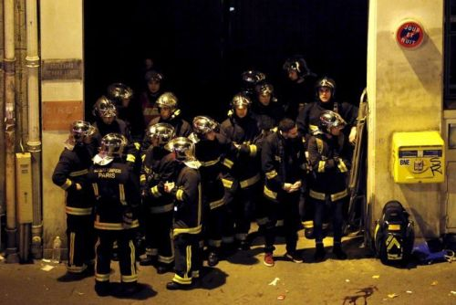 French fire brigade members gather near the Bataclan concert hall