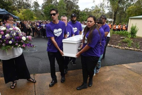 Tiahleigh Palmer's family carry her coffin into the memorial service.