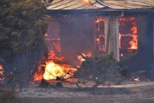 Flames engulf a house north of Adelaide