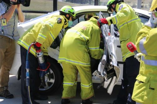Using the jaws of life to free a Canberra Times journalist from a car.
