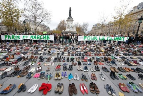Banners are displayed among hundreds of pairs of shoes on the Place de la Republique in Paris.
