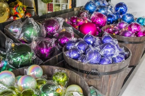 Buckets of baubles the size of basketballs are sorted in colour to make it easy for hanging.