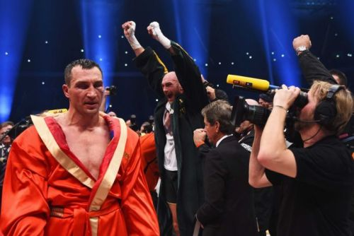 Tyson Fury (2ndL) after beating Wladimir Klitschko (L) to become world heavyweight champion.
