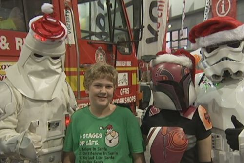 Stormtroopers dress in festive gear to greet children at the Special Children Christmas Party