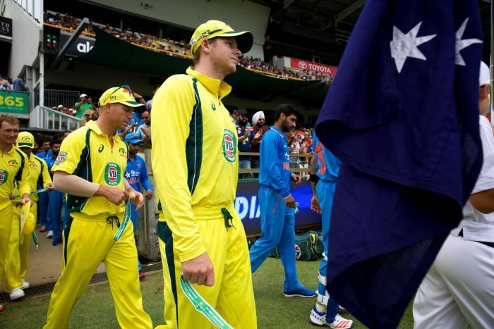 Captain Steve Smith and vice-captain David Warner lead out the Australia side
