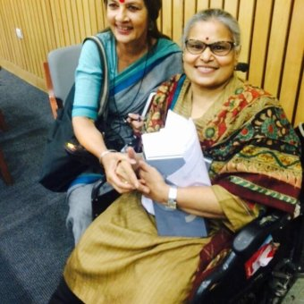 Anita Ghai sits in a wheel chair.