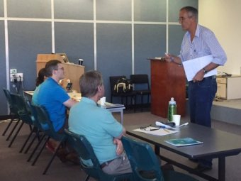 Australian author Tony Park speaks to military veterans in a creative writing class in Perth.