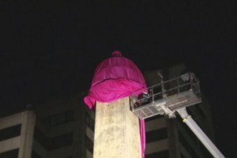 Giant pink condom goes onto obelisk