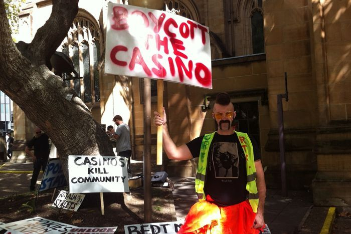 A man holds up a sign calling on people to boycott the city's casinos.