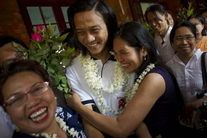 Family members welcome a student protest leader as he arrives for his trial in Tharrawaddy.
