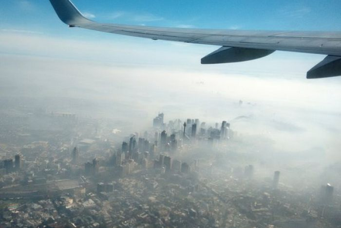 View of Sydney CBD shrouded in bushfire smoke from a plane.