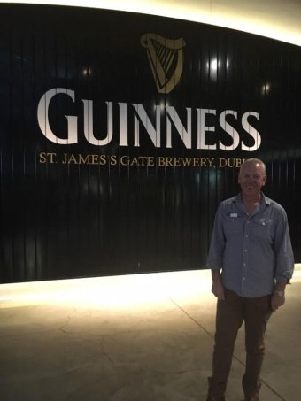 South Australian Police Commissioner Grant Stevens stands in front of a sign at the Guinness factory in Dublin.