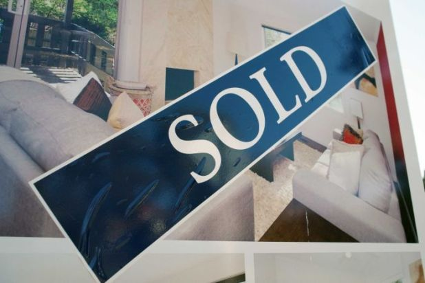 A for sale sign on a Canberra property.