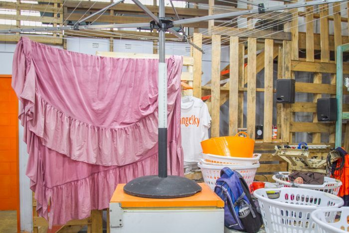 Laundry baskets and inside clothes lines are found inside of the Orange Sky Laundry workshop.