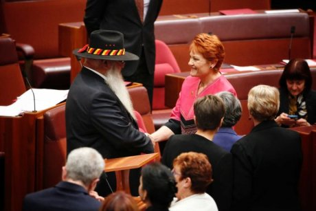 Labor Senator Pat Dodson shakes hands with One Nation Senator Pauline Hanson.