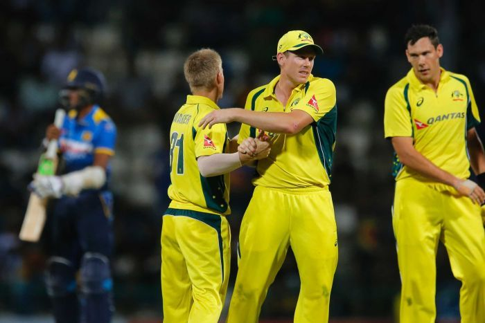 Australian players celebrate their win over Sri Lanka in the T20 at Pallekele