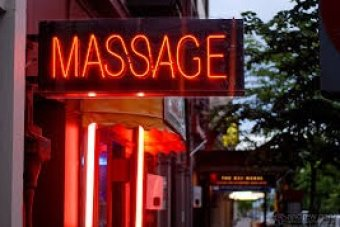 Young boys and girls are being advertised by massage parlours on the Gold Coast.