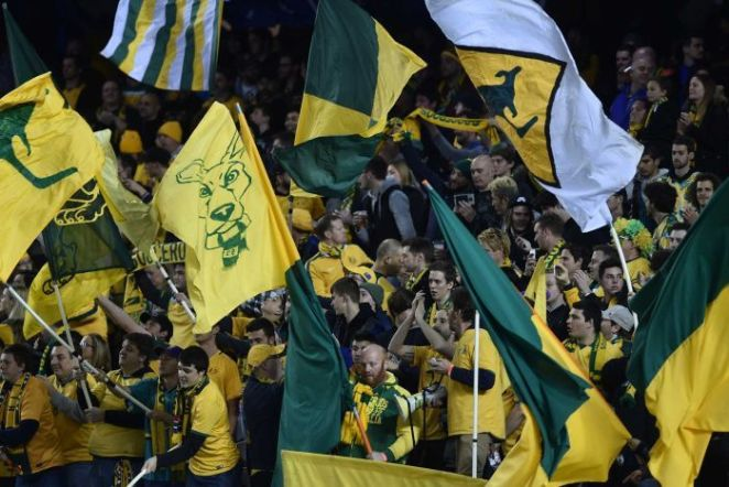 Socceroos fans wave banners ahead of World Cup qualifier against Japan.