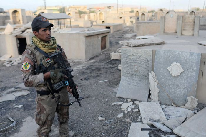 Iraqi soldier in Christian cemetary
