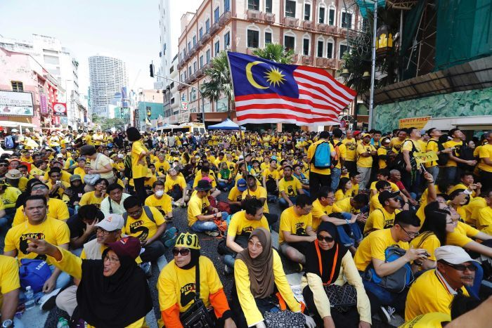 Anti-government protesters occupy a street during a rally in Kuala Lumpur, Malaysia.