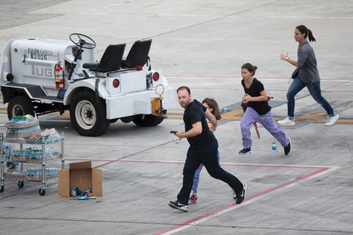 People run on the tarmac at Fort Lauderdale airport