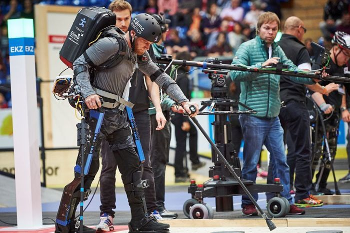 A man in a bionic exoskeleton competes in a race