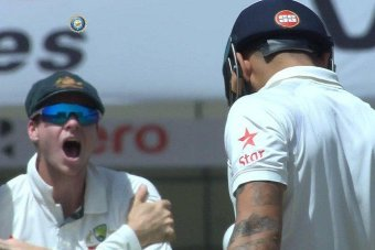 TV still of Steve Smith celebrating in front of Virat Kohli