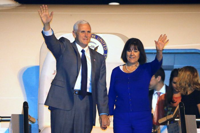 US Vice-President Mike Pence and his wife karen wave from the plane as they disembark in Sydney
